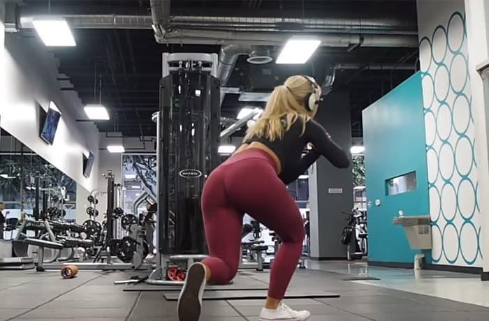 Affondo indietro incrociato da posizione di squat